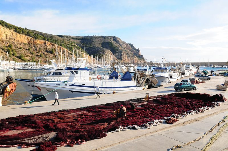 Javea port mending fishing nets